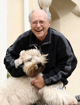 older man with his dog free of allergy symptoms after receiving treatment from smith allergy and asthma specialists of central ny